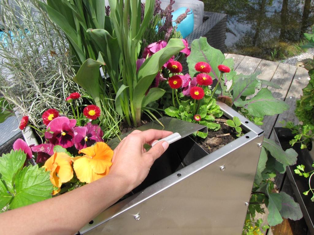 Kompostierung im Hochbeet für Balkon